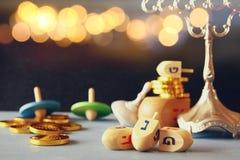 Jewish holiday Hanukkah with wooden dreidels Royalty Free Stock Image