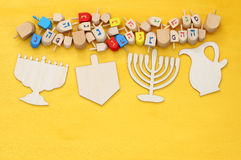 jewish holiday Hanukkah with wooden dreidels (spinning top) Stock Photography
