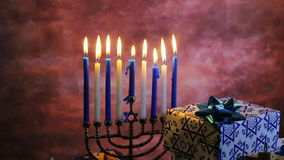 Jewish holiday HanukkahBeautiful Chanukah decorations in blue and silver with gifts. Jewish holiday Hanukkah Beautiful Chanukah decorations in blue and silver stock footage