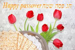 Jewish holiday - Happy Passover. Jewish holiday of Passover and its attributes, with matzo and spring tulips - Happy Passover stock image