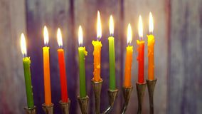 Brightly glowing hanukkah menorah - shallow depth of field selective soft focus. Jewish holiday, holiday symbol hanukkah brightly glowing hanukkah menorah stock video footage