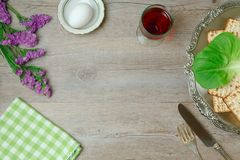 Jewish holiday Passover background. With wine, matzo and seder plate. Top view Stock Photos