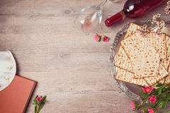 Jewish holiday Passover background with matzah, seder plate and wine. View from above Royalty Free Stock Photos