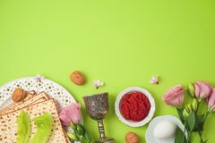 Jewish holiday Passover background with matzo, seder plate and spring flowers stock photos