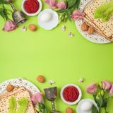 Jewish holiday Passover background with matzo, seder plate and spring flowers royalty free stock images