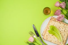 Jewish holiday Passover background with matzo, seder plate and spring flowers royalty free stock photography