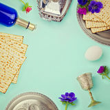 Jewish holiday Passover background with matzo, wine and flowers. Retro filter Royalty Free Stock Photography