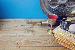 Jewish holiday Passover background with matzo and wine. On wooden table Royalty Free Stock Photography