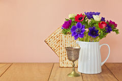 Jewish holiday Passover background with matzoh and spring flowers Royalty Free Stock Image