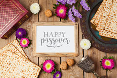 Jewish holiday Passover background with photo frame, matza and seder plate. Stock Photography