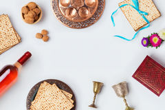 Jewish holiday Passover background with wine, matza and seder plate. View from above. Stock Photography