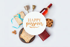 Jewish holiday Passover banner design with wine, matza and seder plate on white background. View from above. Stock Photo