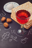 Jewish holiday Passover celebration with matzo and wine on chalkboard Royalty Free Stock Photo