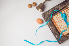 Jewish holiday Passover concept with matzah, egg and wine glass on white background. View from above. Royalty Free Stock Images