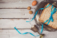 Jewish holiday Passover concept with matzah, seder plate and wine glass on white table background. View from above. Royalty Free Stock Photography