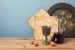 Jewish holiday Passover concept with wine, matza and seder plate Stock Images