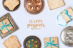 Jewish holiday Passover frame composition. With matzo and seder plate on white background. View from above. Flat lay.Translation for Hebrew Text: Passover Royalty Free Stock Photo