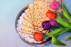 Jewish holiday of Passover and its attributes. With matzo and spring tulips - Happy Passover Stock Photo