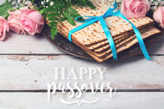 Jewish holiday Passover Pesah greeting card with  matzoh and rose flowers Stock Photo