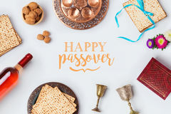 Jewish holiday Passover Pesah greeting card with wine, matza and seder plate. View from above. Royalty Free Stock Images