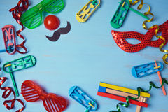 Jewish holiday purim background with carnival mask, party costume and noisemaker. View from above stock image