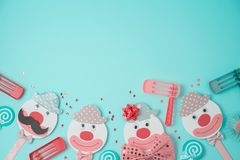 Jewish holiday Purim background with cute paper clowns characters and noisemaker. Top view from above. Flat lay stock images