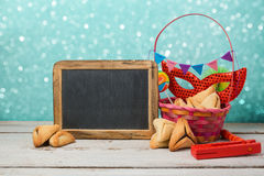 Jewish holiday Purim concept with hamantaschen cookies or hamans ears and carnival mask Stock Photo
