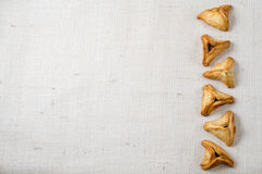 Jewish holiday of Purim. Hamantaschen cookies on canvas background with free space for text Stock Photography