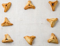Jewish holiday of Purim. Hamantaschen cookies on canvas background with free space for text Royalty Free Stock Photography