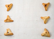 Jewish holiday of Purim. Hamantaschen cookies on canvas background with free space for text Stock Photos