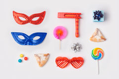 Jewish holiday Purim mock up template with carnival mask, hamantaschen cookies and candy. View from above. Stock Photos