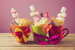 Jewish holiday Purim traditional gifts with hamantaschen cookies and candy Royalty Free Stock Photography