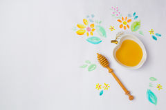 Jewish holiday Rosh Hashana background with honey and watercolor drawings. View from above. Royalty Free Stock Image