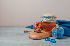 Jewish holiday Rosh Hashana still life with honey jar and chocolate box. On wooden table Royalty Free Stock Photography
