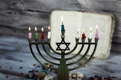 Brightly Glowing Hanukkah Menorah - Shallow Depth of Field. Jewish holiday, Holiday symbol Hanukkah Brightly Glowing Hanukkah Menorah - Shallow Depth of Field