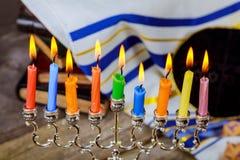 Jewish holiday, Holiday symbol Hanukkah, the Jewish Festival of Lights. Jewish holiday, Holiday symbol Hanukkah Brightly Glowing Hanukkah Menorah - Shallow Depth Royalty Free Stock Photo