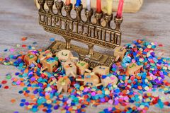 Image of jewish holiday Hanukkah with wooden dreidel spinning top on the glitter background. Jewish holiday, Holiday symbol Hanukkah Image of jewish holiday Stock Photos