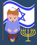 Jewish kid with spinning top, hanukkah greetings Royalty Free Stock Photography