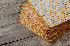 Jewish kosher matzo for Passover a wooden table. Royalty Free Stock Images