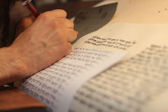 Jewish man with beard writing on a parchment scroll. Photo taken on: December 30th,2015 Stock Images