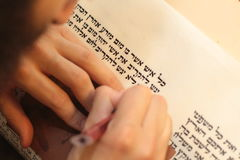 Jewish man with beard writing on a parchment scroll. Photo taken on: December 30th,2015 Stock Photo