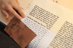 Jewish man with beard writing on a parchment scroll. Photo taken on: December 30th,2015 Royalty Free Stock Images