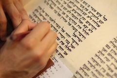 Jewish man with beard writing on a parchment scroll. Photo taken on: December 30th,2015 Stock Image