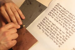 Jewish man with beard writing on a parchment scroll. Photo taken on: December 30th,2015. A sacred roll which write manually Royalty Free Stock Photos