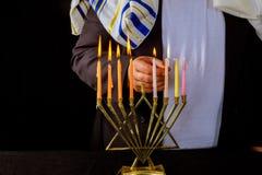Jewish man blessings Chanukah menorah traditional Hanukkah. The lighting of the Menorah royalty free stock image