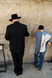 Jewish man and child praying. At the Western wall in Jerusalem Royalty Free Stock Photography