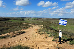 Jewish man fly flag of Israel near Gaza Strip Royalty Free Stock Images