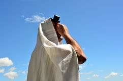 Jewish man pray to God under the open blue sky