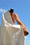 Jewish man pray. Jewish man wearing Tallit and Tefillin pray to God under the blue sky on Jewish holiday Stock Photography