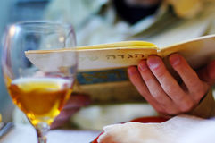 Jewish man reads the Haggadah on Passover Seder Meal Stock Photography